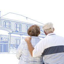 Elderly couple looking at a drawing of a home